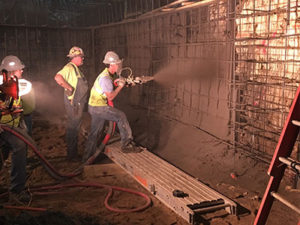 Commercial concrete contractors, overseeing the use of shotcrete.