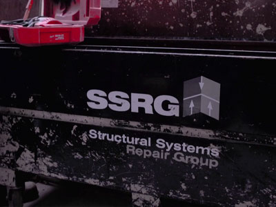 Front of an SSRG toolbox with dirt covering parts of the toolbox