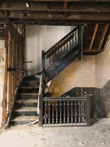 staircase being restored in Mt. Auburn
