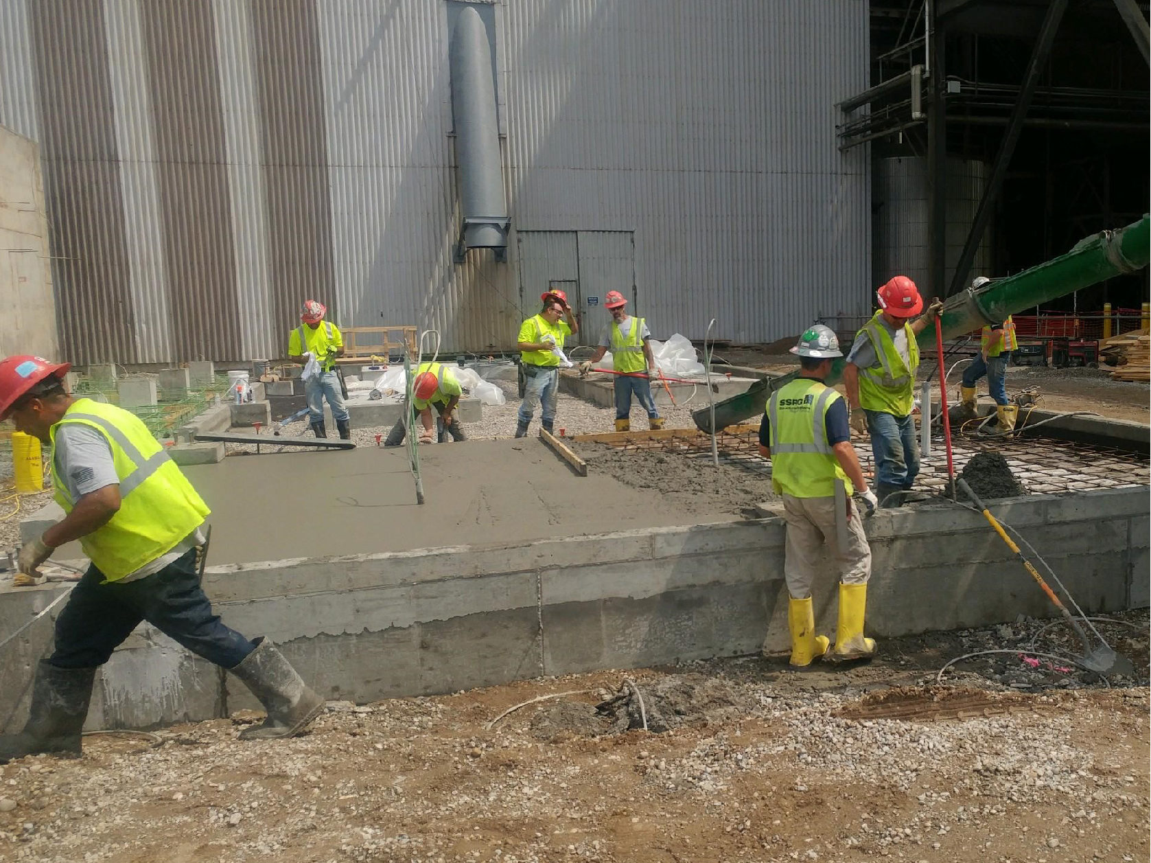 SSRG crew members at work creating concrete foundations as part of Duke energy job site, where they are preparing a foundation for dry ash waste storage.