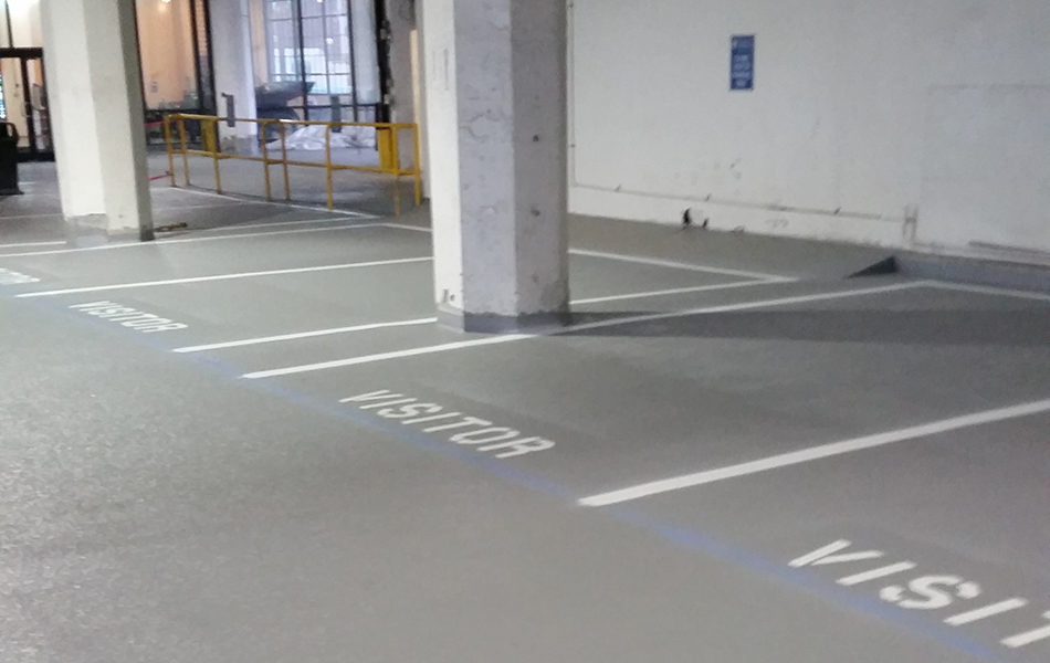 Newly finished visitor parking spots in a parking garage.
