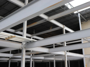 White beams that will be used to construct different levels of a new storage facility.