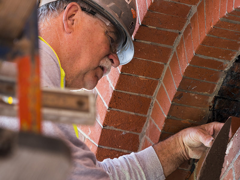 An SSRG masonry worker laying bricks at Cincinnati Music Hall