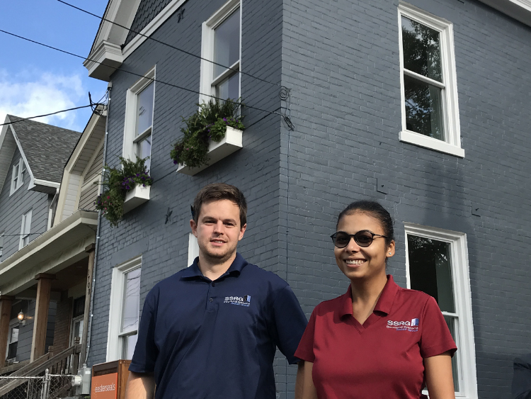Two SSRG team members at YouthBuild house