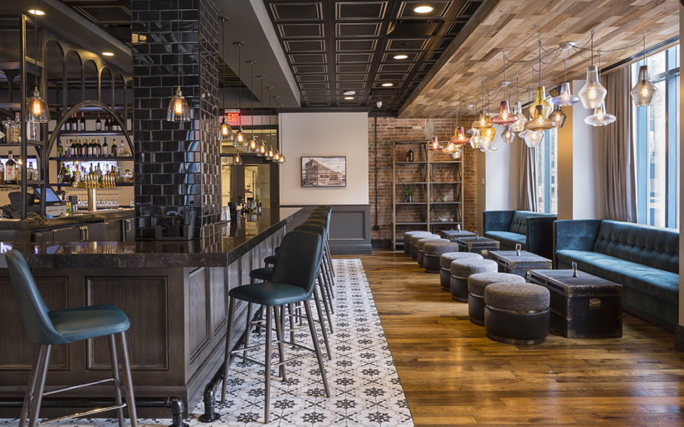 Restaurant and bar with dark wood and exposed brick