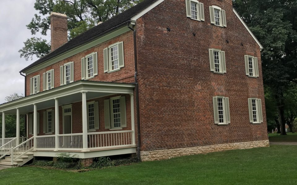side view of house with large porch. locust grove house in louisville, ky