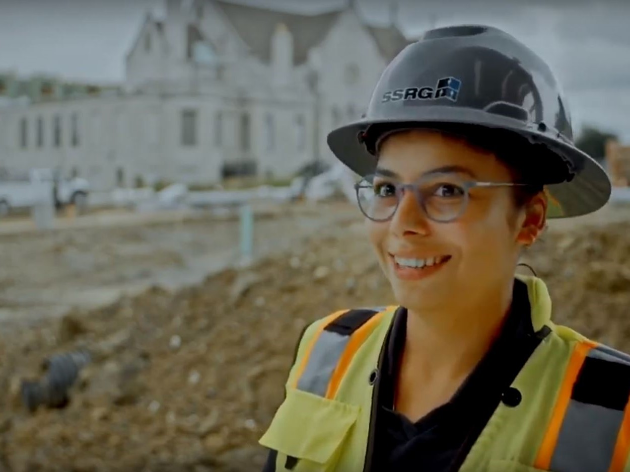 Woman in SSRG hardhat smiling