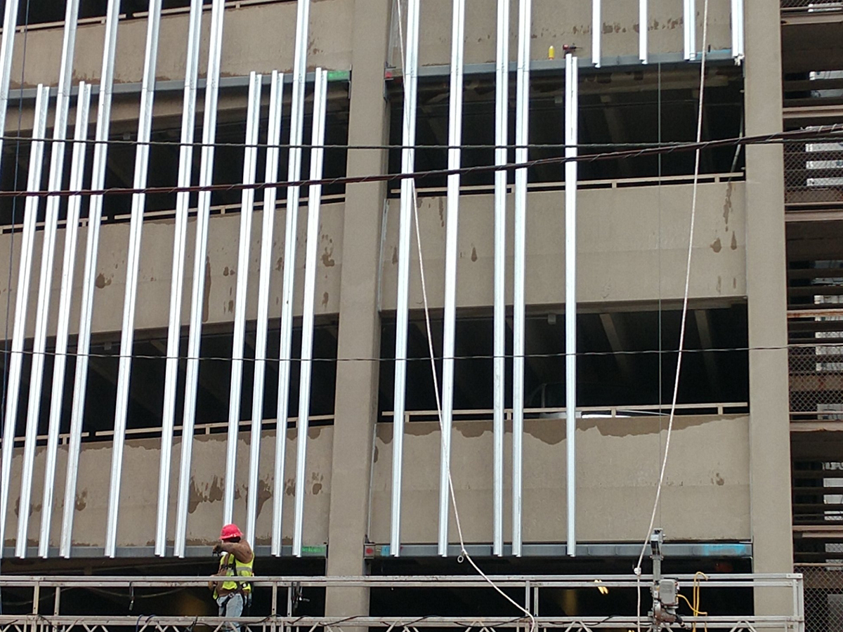 installation of steel screen on parking garage