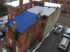 Aerial of roof repairs on old structure in Price Hill