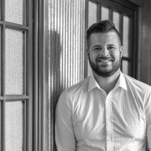 black and white portrait of Bryan Erickson, Vice President of Operations