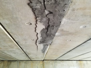 deteriorating concrete near Oxmoor Center