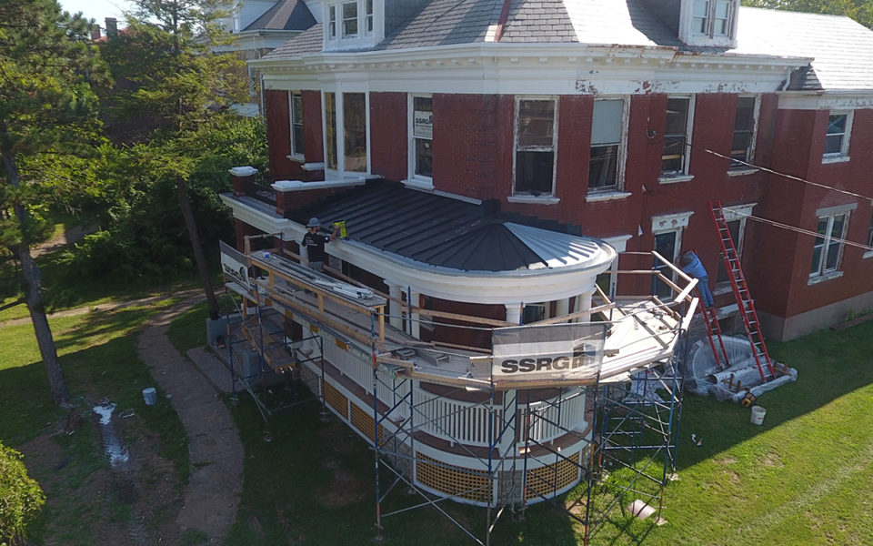 scaffolding and crews at Rubel House