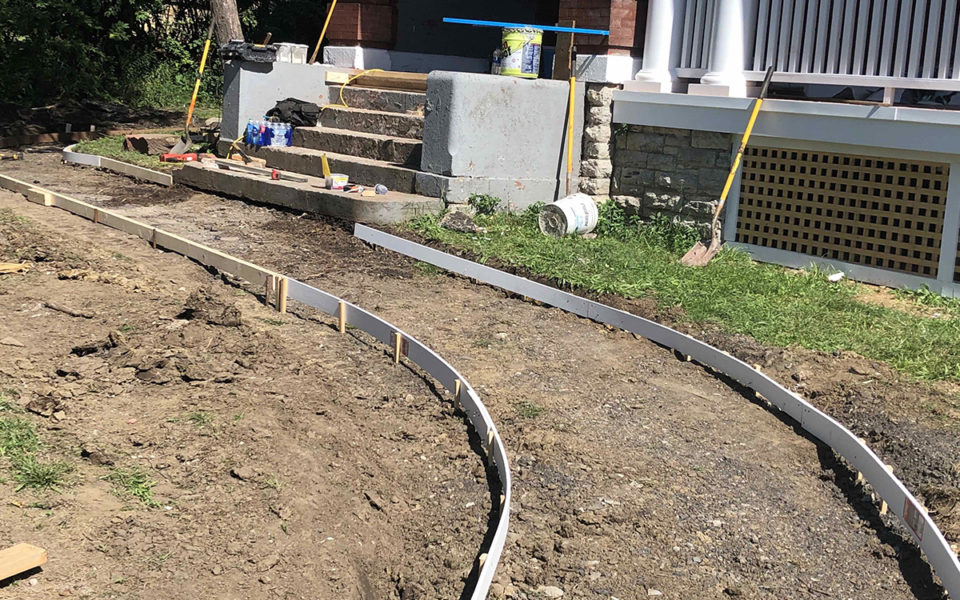concrete sidewalk forms in front of Rubel House