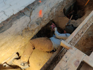 SSRG worker in crawl space