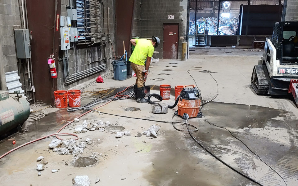 preparing to pour new bollards in facility