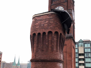 close up of brick tower before repairs