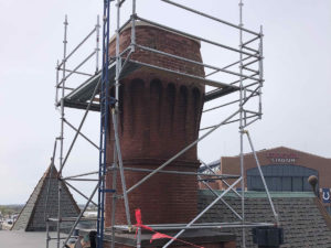 historic masonry brick repair with scaffolding