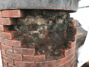 close up of removed bricks in masonry repair