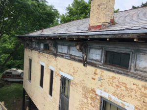 cornices in disrepair on historic roof